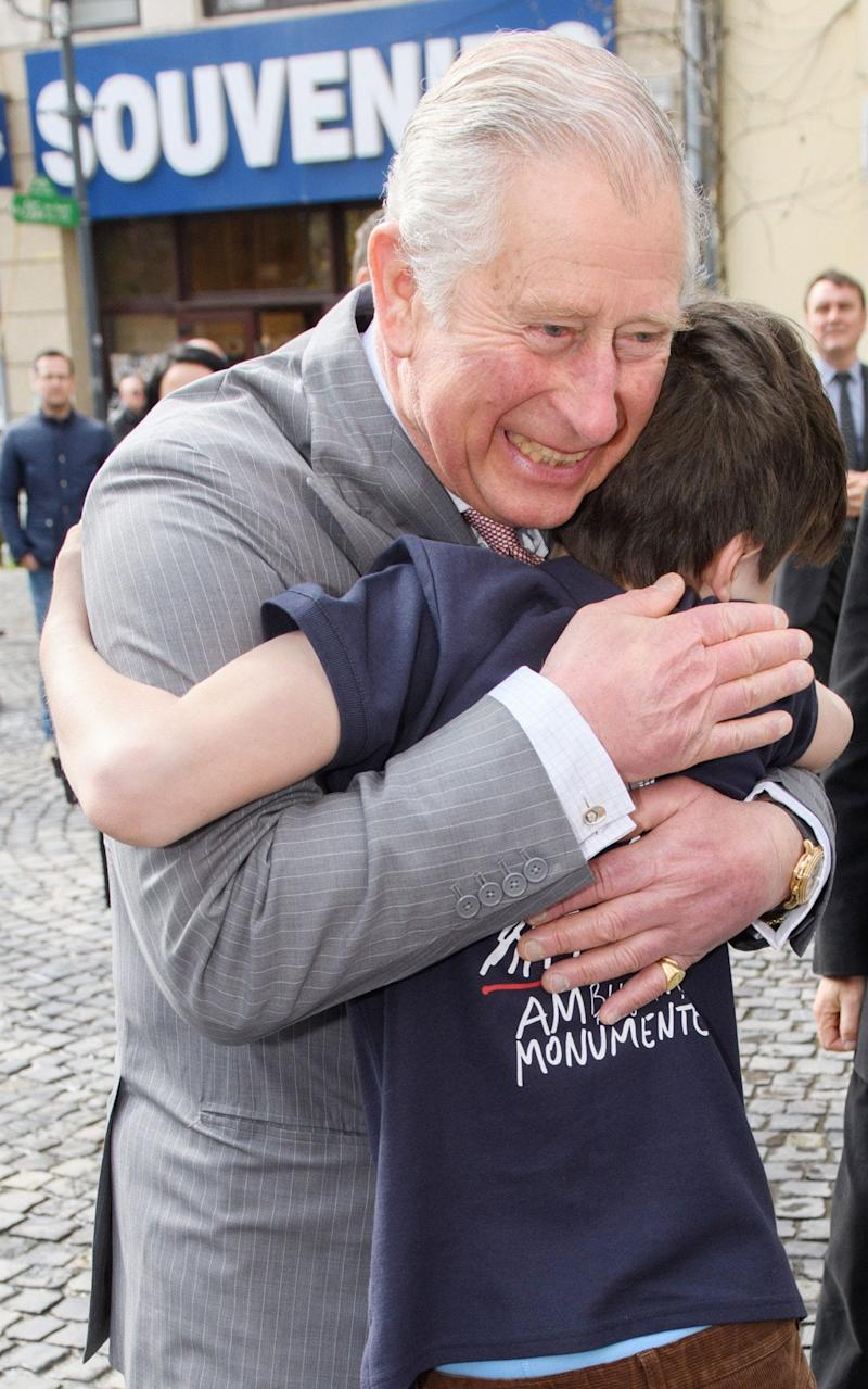 Prince Charles takes a walking tour of the Old Town in Bucharest and hugs Valentin Blacker  - Credit: Tim Rooke/REX/Shutterstock