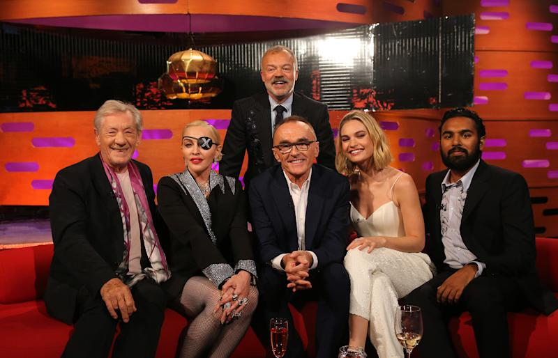 Host Graham Norton with (seated left to right) Sir Ian McKellen, Madonna, Danny Boyle, Lily James, and Himesh Patel during the filming for the Graham Norton Show at BBC Studioworks 6 Television Centre, Wood Lane, London, to be aired on BBC One on Friday evening. (Photo by Isabel Infantes/PA Images via Getty Images)