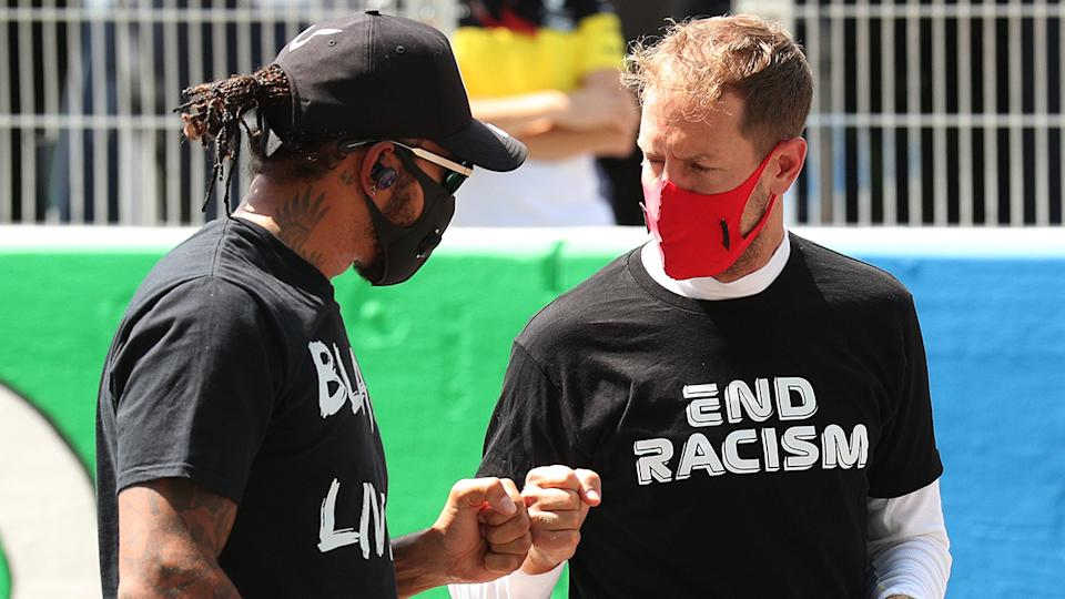 Lewis Hamilton and Sebastian Vettel are pictured fist-bumping prior to the Spanish Grand Prix.