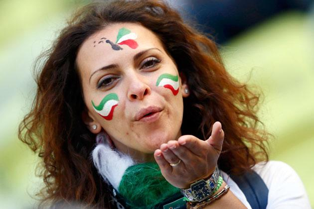 An Italian fan with her face painted blows a kiss as she waits for the start of the Group C Euro 2012 soccer match against Spain in PGE Arena in Gdansk, June 1o, 2012. REUTERS/Kai Pfaffenbach