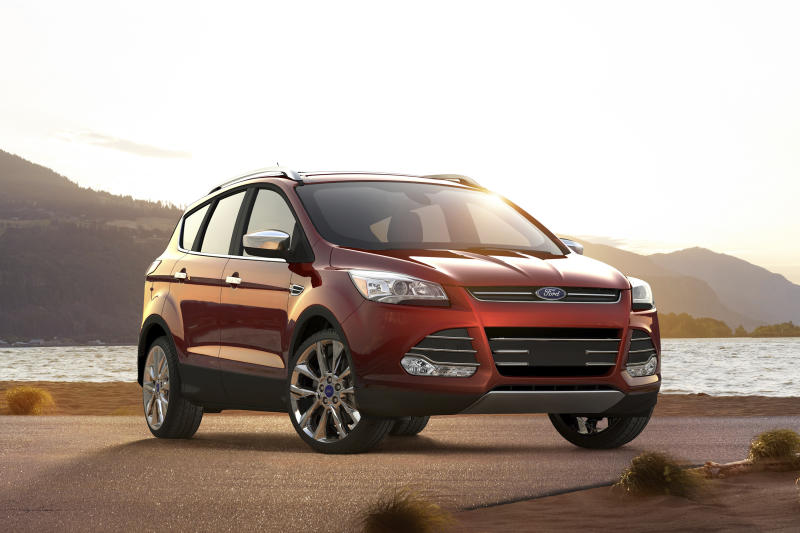This undated photo provided by Ford shows the 2016 Ford Escape, a small crossover SUV. On upper trim levels, it comes with auto-dimming mirrors, blind-spot monitoring and automated parking. (Ford Motor Co. via AP)