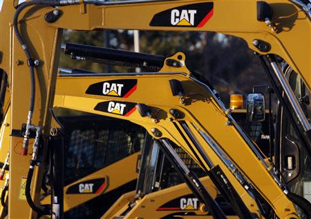 Caterpillar machines are pictured on a lot at Milton CAT in North Reading, Massachusetts in this January 23, 2013 file photo. REUTERS/Jessica Rinaldi/Files