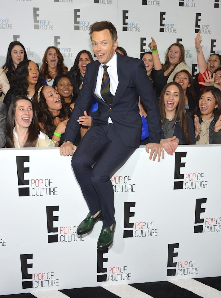 NEW YORK, NY - APRIL 22:  Comedian Joel McHale jumps into the crowd at the E! 2013 Upfront at The Grand Ballroom at Manhattan Center on April 22, 2013 in New York City.  (Photo by Mike Coppola/Getty Images)