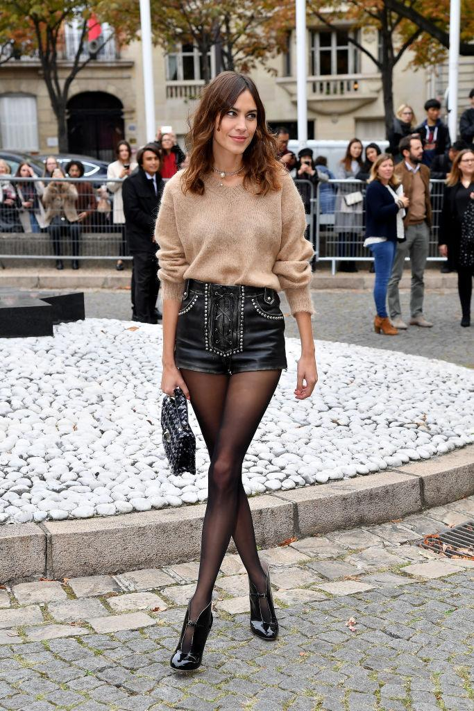 <p>On October 2, Alexa Chung attended the Miu Miu SS19 show in lace-up shorts and a soft knit. It's official: tights season is upon us. [Photo: Getty] </p>