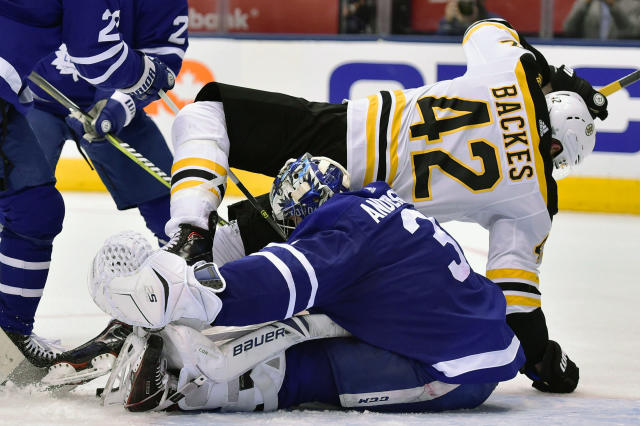 Boston Bruins right wing David Backes (42) falls overToronto Maple Leafs goaltender Frederik Andersen (31) during third period NHL round one playoff hockey action in Toronto on Monday, April 23, 2018. (Frank Gunn/The Canadian Press via AP)