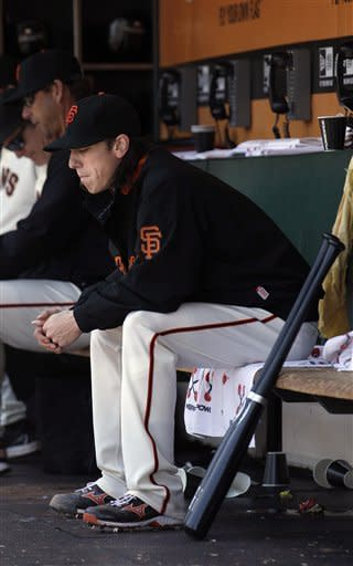 San Francisco Giants pitcher Tim Lincecum sits in the dugout after being relieved during the fifth inning of a baseball game against the San Diego Padres in San Francisco, Wednesday, July 25, 2012. The Padres won 6-3. (AP Photo/Jeff Chiu)