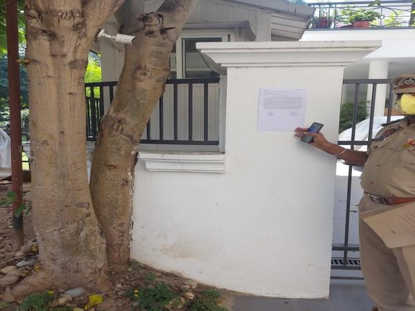 Summons had to be pasted outside the residence of Saini on the gate due to his non-availability. [Photo/ANI]