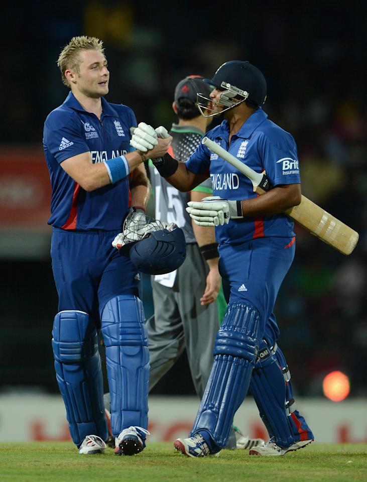 COLOMBO, SRI LANKA - SEPTEMBER 21:  Luke Wright of England is congratulated by teammate Samit Patel after his innings of 99 not out during the ICC World Twenty20 2012 Group A match between England and Afghanistan at R. Premadasa Stadium on September 21, 2012 in Colombo, Sri Lanka.  (Photo by Gareth Copley/Getty Images)