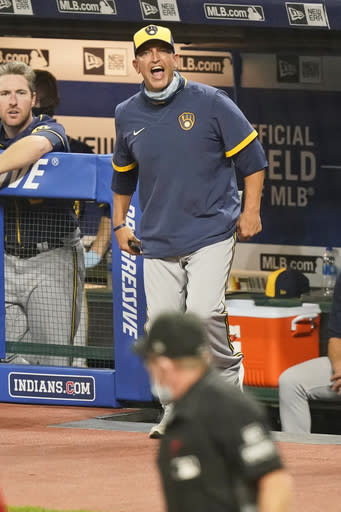 Milwaukee Brewers hitting coach Andy Haines argues a call with home plate umpire Jerry Meals after getting ejected in the seventh inning in a baseball game against the Cleveland Indians, Friday, Sept. 4, 2020, in Cleveland. (AP Photo/Tony Dejak)