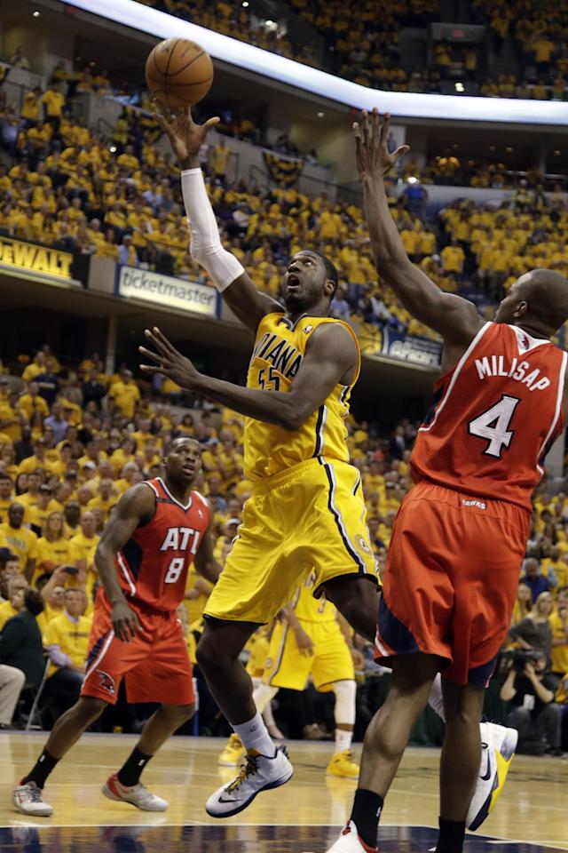 Indiana Pacers center Roy Hibbert (55) shoots in front of Atlanta Hawks forward Paul Millsap (4) in the second half during Game 7 of a first-round NBA basketball playoff series in Indianapolis, Saturday, May 3, 2014. The Pacers won 92-80. (AP Photo/AJ Mast)