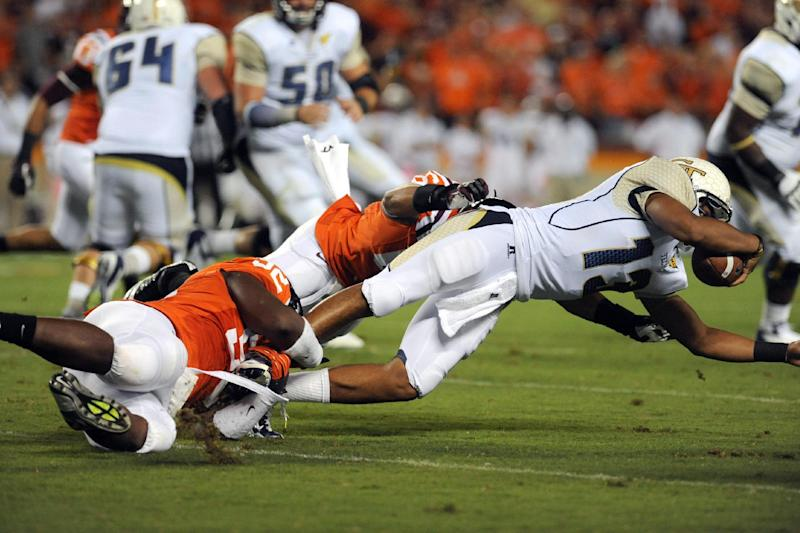 Virginia Tech defenders take down Georgia Tech quarterback Tevin Washington (13) during their NCAA college football game, Monday, Sept. 3, 2012, in Blacksburg, Va. (AP Photo/Don Petersen)