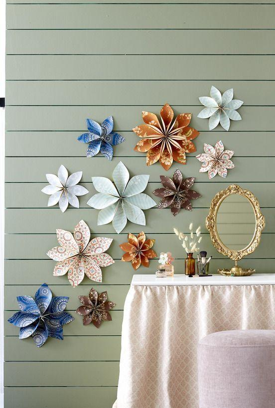 "<p>Transform wallpaper remnants into floating flowers. Trace and cut out 8 to 12 (depending on sizes) petals on backs of wallpaper remnants. Pinch together one end of each petal, and secure with hot-glue. Once dry, glue petals together in a circle. Secure to wall with pushpins.</p><p><strong>Get the step-by-step how-to:</strong> <a href=""https://www.countryliving.com/diy-crafts/a35281093/wallpaper-flowers/"" rel=""nofollow noopener"" target=""_blank"" data-ylk=""slk:How to Make Wallpaper Flowers"" class=""link rapid-noclick-resp"">How to Make Wallpaper Flowers</a></p>"