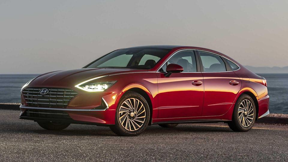 """<p><strong>Score: 7.3 / 10</strong></p> <p>The new <a href=""""https://www.motor1.com/reviews/431000/2020-hyundai-sonata-hybrid-limited-sedan-review/"""" rel=""""nofollow noopener"""" target=""""_blank"""" data-ylk=""""slk:Hyundai Sonata"""" class=""""link rapid-noclick-resp"""">Hyundai Sonata</a> is a great car – in fact, this is the second time it shows up on this list. But the Hybrid Limited model is our favorite, getting an impressive score of 7.3 out of 10 on our star rating system. Obviously the Sonata Hybrid scores well in fuel economy, achieving 45 miles per gallon city, 51 highway, and 47 combined, but it's also nice to drive, safe, and offers some of the best technology and connectivity in the segment. The 2020 Hyundai Sonata Hybrid starts at just $27,750; our well-equipped Limited cost $36,275.</p> <br><a href=""""https://www.motor1.com/reviews/431000/2020-hyundai-sonata-hybrid-limited-sedan-review/"""" rel=""""nofollow noopener"""" target=""""_blank"""" data-ylk=""""slk:2020 Hyundai Sonata Hybrid Limited Review: Making A Good Thing Better"""" class=""""link rapid-noclick-resp"""">2020 Hyundai Sonata Hybrid Limited Review: Making A Good Thing Better</a><br>"""