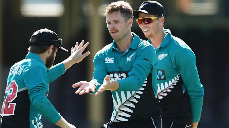 Lockie Ferguson, pictured here celebrating with teammates after taking the wicket of David Warner.
