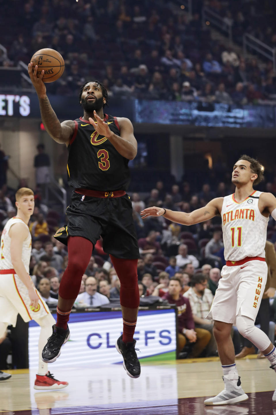 Cleveland Cavaliers' Andre Drummond (3) shoots against the Atlanta Hawks' Trae Young in the first half of an NBA basketball game, Wednesday, Feb. 12, 2020, in Cleveland. (AP Photo/Tony Dejak)