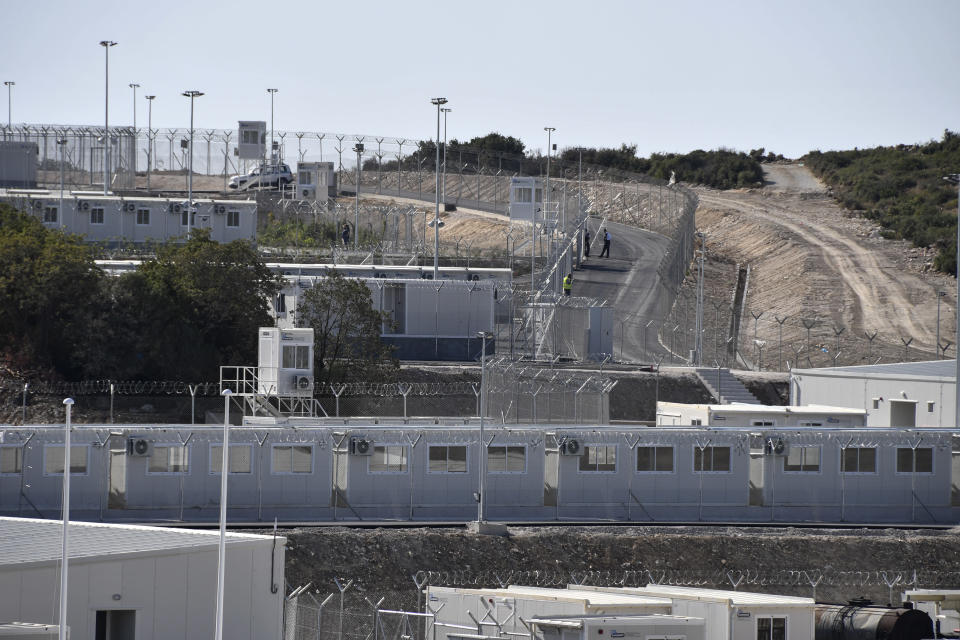 A view of the new multi-purpose reception and identification migrant centre which was constructed near Vathy town, on the eastern Aegean island of Samos, Greece, Saturday, Sept. 18, 2021. The centre constructed following a 121 million euros agreement between the European Commission and the Greek Ministry of Migration and Asylum, an amount granted to Greece for the construction of 3 reception centres on the islands of Samos, Kos, and Leros. (AP Photo/Michael Svarnias)
