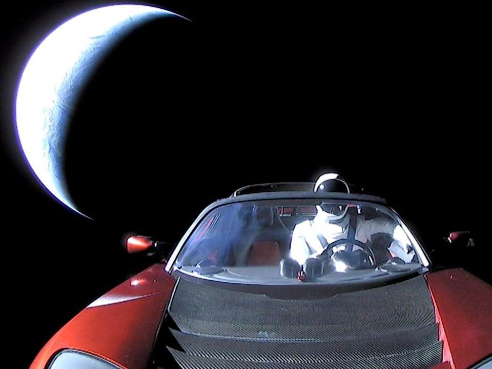 A Tesla roadster launched from the Falcon Heavy rocket with a dummy driver named 'Starman'  heads towards Mars (Getty Images)