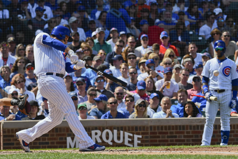 Chicago Cubs' Anthony Rizzo hits an RBI single during the fourth inning of a baseball game against the San Francisco Giants Thursday, Aug. 22, 2019, in Chicago. (AP Photo/Matt Marton)