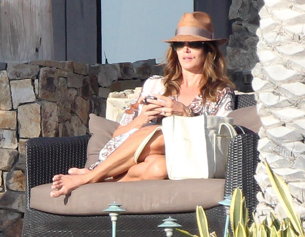 "Supermodel Cindy Crawford made sure to protect her skin from the sun with a funky hat while lounging at the star-friendly destination. Clasos.com/<a href=""http://www.splashnewsonline.com"" target=""new"">Splash News</a> - December 28, 2010"