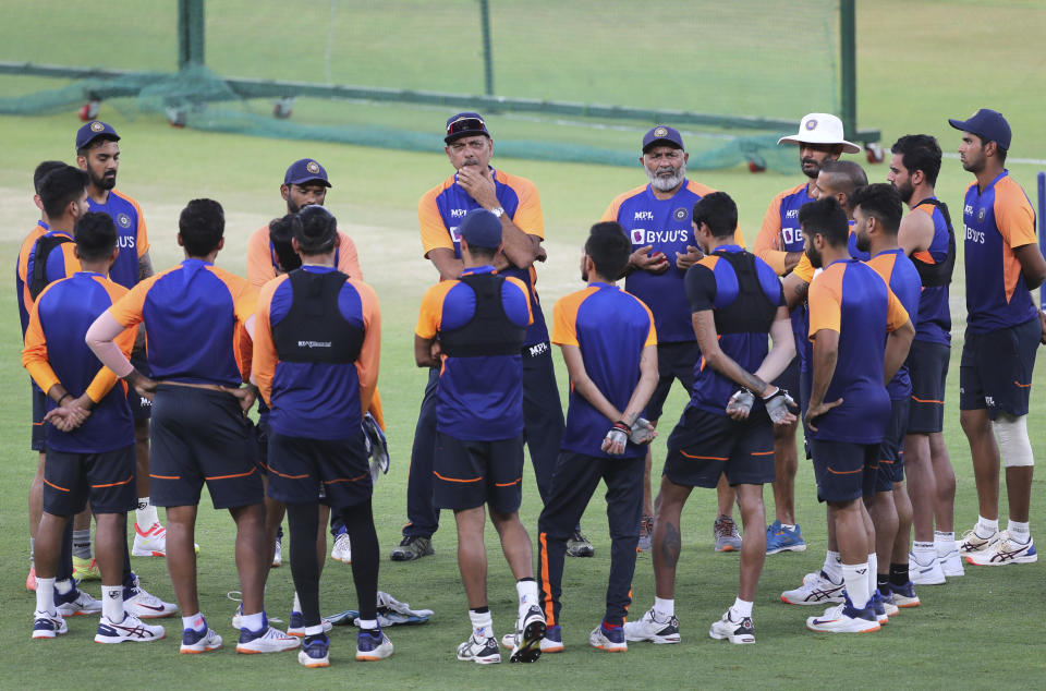 Indian cricket team players listen to their coach during a training session ahead of the first Twenty20 cricket match between India and England in Ahmedabad, India, Tuesday, March 9, 2021. (AP Photo/Aijaz Rahi)