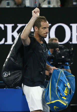 Tennis - Australian Open - Rod Laver Arena, Melbourne, Australia, January 20, 2018. Richard Gasquet of France waves as he leaves after losing against Roger Federer of Switzerland. REUTERS/Thomas Peter