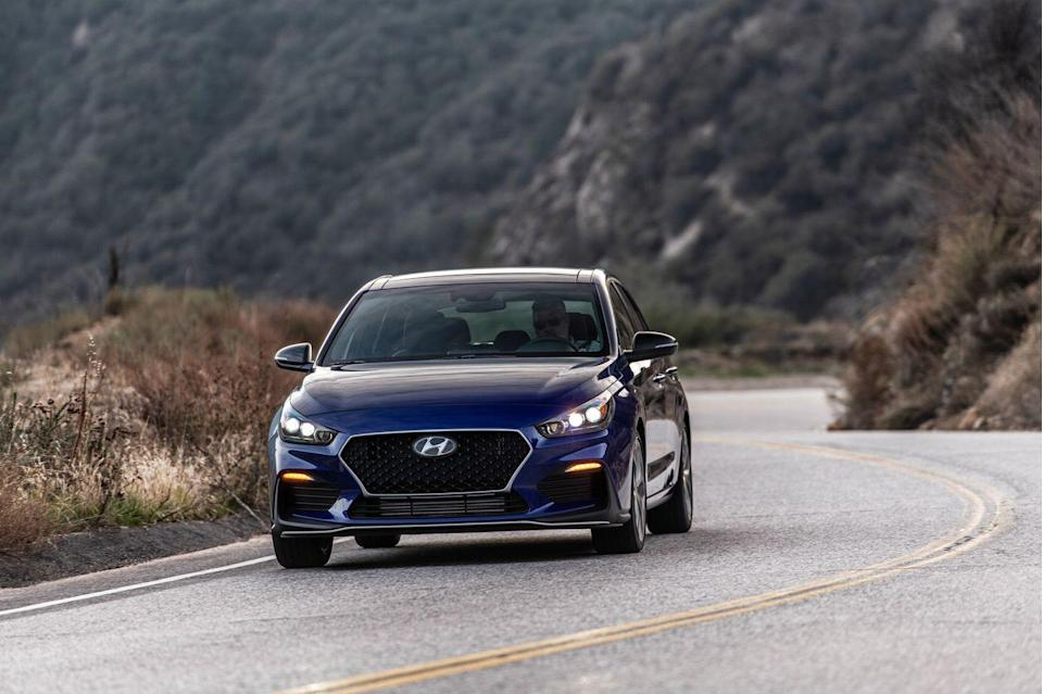 <p>The new exterior bits consist of a new mesh front grille, a deeper front bumper with larger intakes, black side mirrors, special 18-inch wheels with Michelin Pilot Sport 4 tires (on models equipped with the manual transmission), a rear diffuser with dual exhaust, and N Line badging.</p>