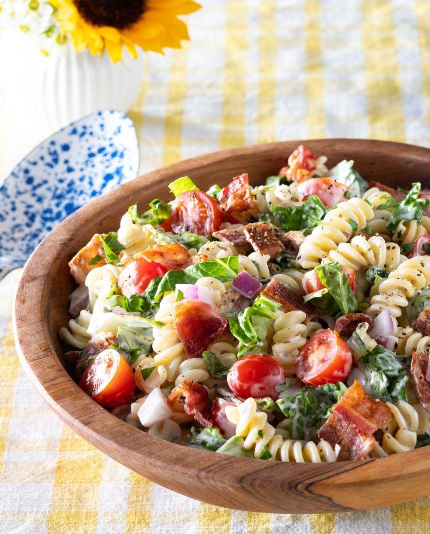 """<p>All the ingredients of a classic BLT (bacon, lettuce, and tomato) in pasta form! This easy, summer pasta salad is great for taking <a href=""""https://www.thepioneerwoman.com/food-cooking/meals-menus/g32382151/picnic-side-dishes/"""" rel=""""nofollow noopener"""" target=""""_blank"""" data-ylk=""""slk:to a picnic"""" class=""""link rapid-noclick-resp"""">to a picnic</a> or a 4th of July potluck. </p><p><a href=""""https://www.thepioneerwoman.com/food-cooking/recipes/a36068261/blt-pasta-salad-recipe/"""" rel=""""nofollow noopener"""" target=""""_blank"""" data-ylk=""""slk:Get the recipe."""" class=""""link rapid-noclick-resp""""><strong>Get the recipe.</strong></a></p><p><a class=""""link rapid-noclick-resp"""" href=""""https://go.redirectingat.com?id=74968X1596630&url=https%3A%2F%2Fwww.walmart.com%2Fsearch%2F%3Fquery%3Dpioneer%2Bwoman%2Bserving%2Bbowl&sref=https%3A%2F%2Fwww.thepioneerwoman.com%2Ffood-cooking%2Fmeals-menus%2Fg36500577%2Ftomato-recipes%2F"""" rel=""""nofollow noopener"""" target=""""_blank"""" data-ylk=""""slk:SHOP SERVING BOWLS"""">SHOP SERVING BOWLS</a></p>"""