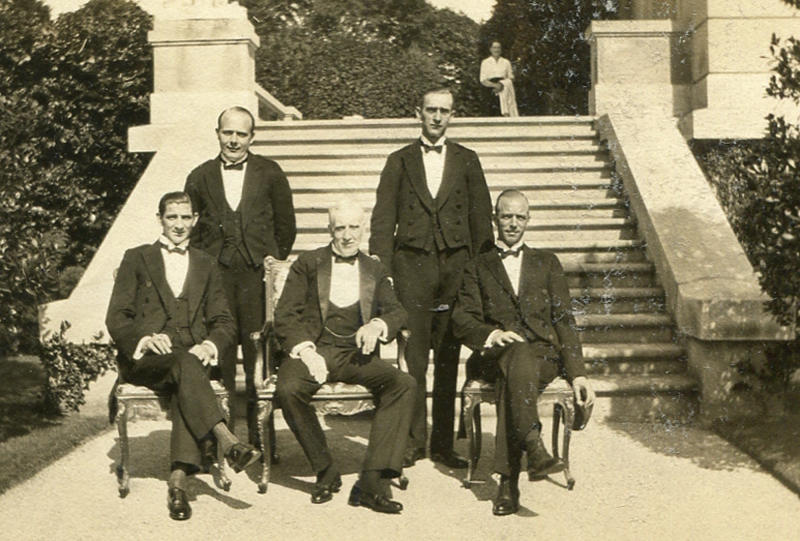 "This circa 1920s photo provided by The Preservation Society of Newport County shows butler Ernest Birch, center, surrounded by footmen next to the terrace of The Elms mansion in Newport, R.I. Newly discovered photographs, documents and family histories have inspired the creation of a tour about servants at The Elms, echoing themes of the British drama program, ""Downton Abbey."" (AP Photo/The Preservation Society of Newport County)"