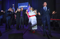 FILE - In this Thursday, July 23, 2020 file photo, from right, Ralph Reed, Dr. Alveda King, Journey keyboardist Jonathan Cain, and personal pastor to the president, Paula White Cain, and others pray on stage during a Donald Trump campaign event courting devout conservatives by combining praise, prayer and patriotism in Alpharetta, Ga. Like most fellow evangelicals, Reed left room for the president to eke out a victory even as that path appeared slim on Friday, Nov. 6, 2020. But he also singled out Democrats' lackluster showing in key congressional races as a positive sign and suggested that religious conservatives might see an opportunity to work with a Biden administration that tacks away from the left. (AP Photo/John Amis)