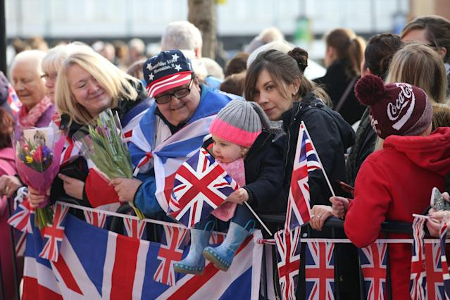 Patriotic crowds line the streets, waiting for a glimpse of the royals. (PA Images)
