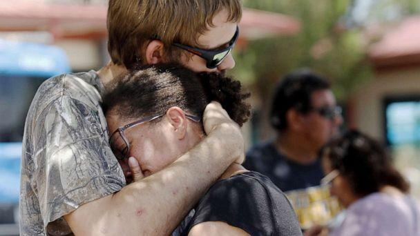 PHOTO:A man comforts a woman who was in the freezer section of a Walmart during a shooting incident, in El Paso, Texas, Aug. 03, 2019. (Ivan Pierre Aguirre/EPA via Shutterstock)