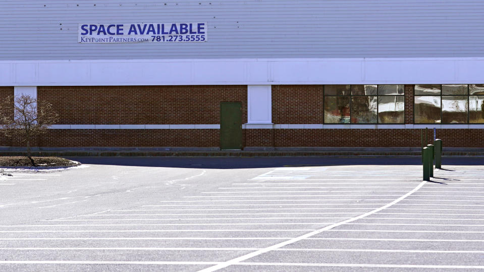 """A """"Space Available"""" real estate sign is posted on the facade of a closed supermarket, Tuesday, March 2, 2021, in Manchester, N.H. After a year of ghostly airports, empty sports stadiums and constant Zoom meetings, growing evidence suggests that the economy is strengthening. Hiring picked up in February 2021. Business restrictions have eased as the pace of viral infections has ebbed. Yet the economy remains far from normal. (AP Photo/Charles Krupa)"""