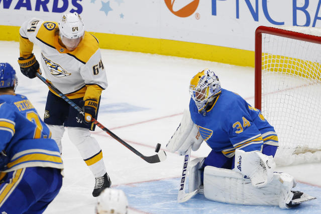 Nashville Predators' Mikael Granlund, of Finland, deflects a shot in front of St. Louis Blues goaltender Jake Allen during the third period of an NHL hockey game Saturday, Feb. 15, 2020, in St. Louis. (AP Photo/Billy Hurst)
