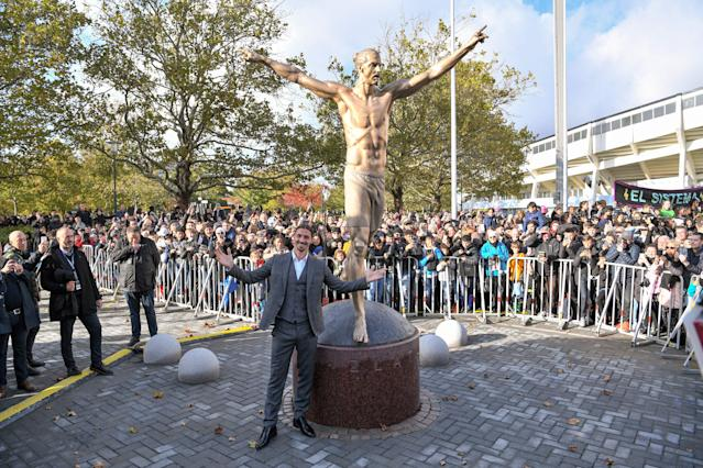 Ibrahimovic poses next to his statue (Credit: Getty Images)