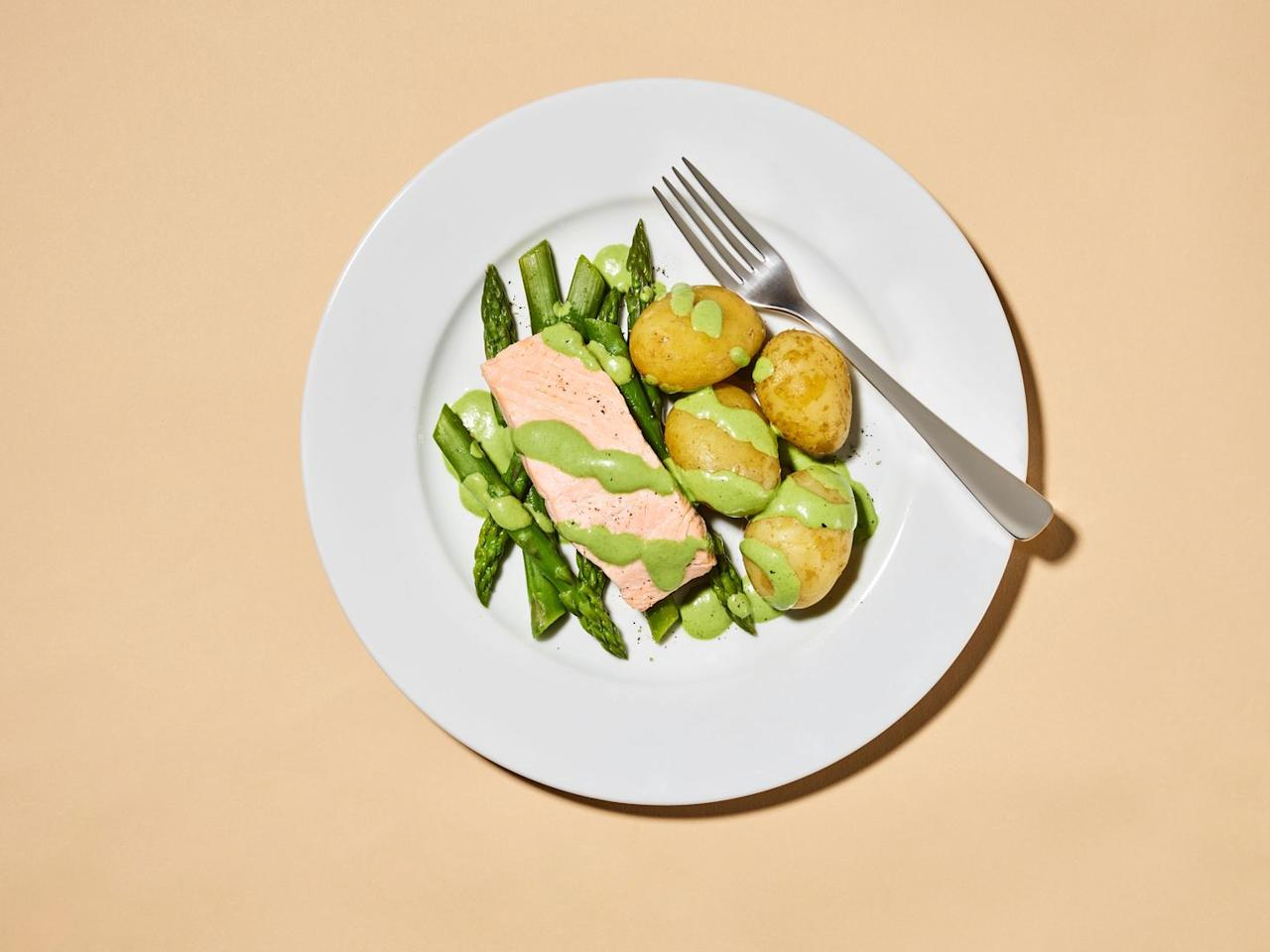 <p>If you're forever finding gungy watercress, seriously pongy salmon and long-gone crème fraîche from, er, two weeks ago in your fridge...</p><p>485 calories - 25g fat - 35g protein - 34g carbs - serves 2.<br></p><p><strong>Ingredients</strong><br>- 500ml whole milk<br>- 2 bay leaves<br>- 1 tsp black peppercorns<br>- 350g Jersey Royal potatoes<br>- 4 salmon fillets<br>- 75g watercress<br>- 2-3 tsp horseradish cream<br>- 150ml crème fraîche<br>- Salt and pepper<br>- 200g asparagus</p><p><strong>Method</strong></p><ol><li>Put the milk, bay leaves and peppercorns in a saucepan (ironically, a milk pan won't do–it needs to be big enough to fit the salmon in) and place it over a gentle heat. You can put the potatoes on to boil now, too – they'll take the same amount of time as the salmon.</li><li>Milk simmering? Carefully drop the salmon fillets in and leave them to poach gently for 10 mins. Meanwhile, get saucy. Grab a blender and chuck in the watercress, horseradish cream and crème fraîche. Blitz until smooth, then season to taste.</li><li>Next, steam the asparagus spears until just tender (2-4 mins depending on their girth – any longer and they go a bit flaccid).</li><li>Use a slotted spoon to lift the salmon fillets out of the poaching liquid – two on to dinner plates (or one on to a plate, one into a food container for lunch tomorrow) and set the other two aside to cool. Don't chuck the poaching milk – you'll need that to make the tart opposite.</li><li>Serve with the potatoes and asparagus and artfully drizzle over half of the sauce, saving the rest for (you guessed it) the tart.</li></ol>