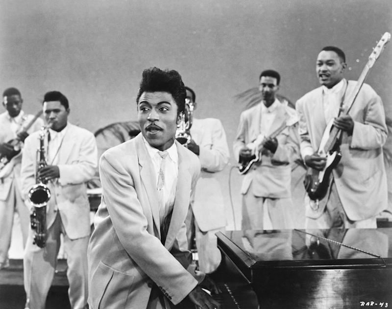 CIRCA 1957: Musician Little Richard performs onstage with his band as his saxophone player Grady Gaines stands on the piano in circa 1957 in scene from the movie 'Mister Rock And Roll.' (Photo by Michael Ochs Archives/Getty Images)