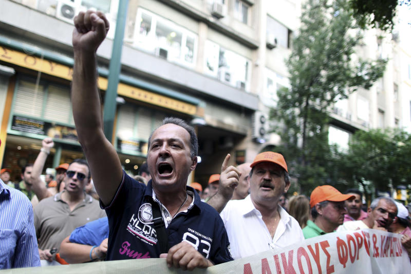 Finance Ministry, tax office and customs employees march in central Athens outside the finance ministry building to protest new austerity measures, on Thursday, Sept. 27, 2012. As the party leaders conferred Thursday, tax and customs employees, who are on strike until Friday against planned pay cuts, held a peaceful protest in the capital. (AP Photo/Petros Giannakouris)
