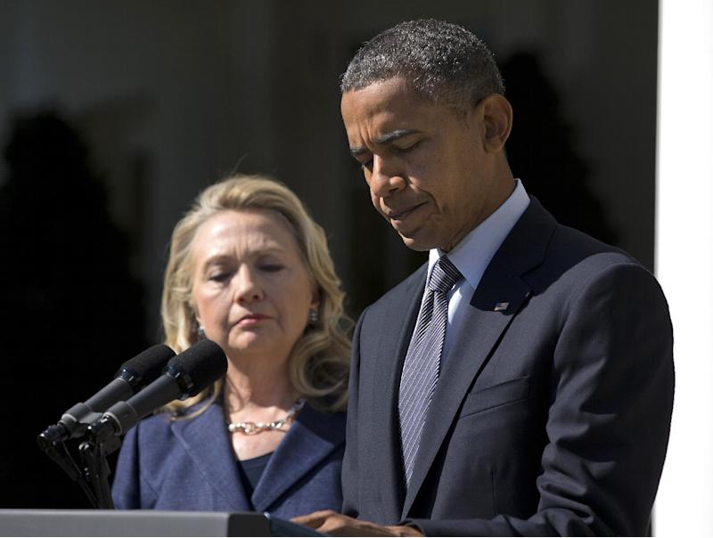 In this Sept. 12, 2012, photo, President Barack Obama, accompanied by Secretary of State Hillary Rodham Clinton, speaks in the Rose Garden of the White House in Washington, about the death of U.S. ambassador to Libya Christopher Stevens. His eye fixed firmly on securing a second term, Obama had hoped that the rest of the world would wait until after the election if it had to grow restless and demand his attention. The eruptions in the streets of the Arab world, inflamed by an anti-Muslim video made in the U.S., mean Obama can put it off no longer. The protests are testing the president's foreign policy skills and giving voters a pre-election view of how he handles a crisis.  (AP Photo/Evan Vucci)