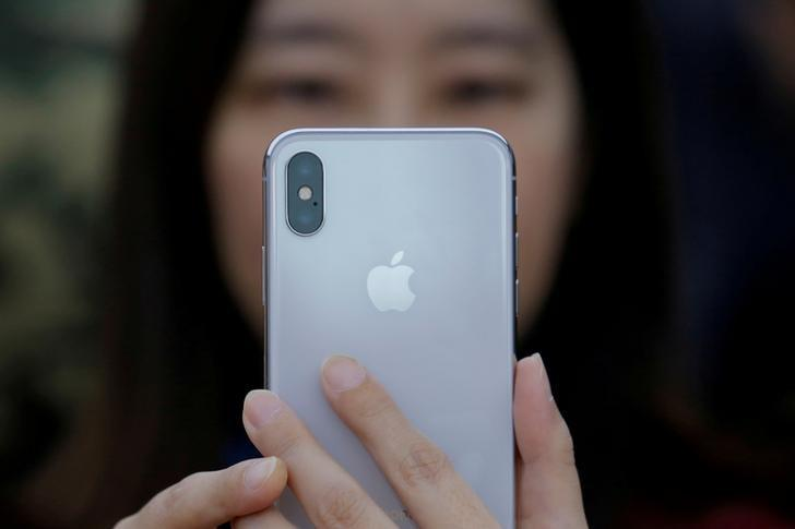 FILE PHOTO - A attendee uses a new iPhone X during a presentation for the media in Beijing