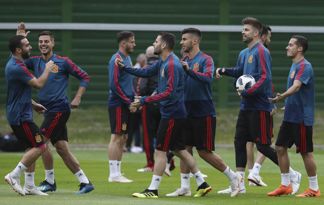 Spain's players smile during the official training on the eve of the group B match between Morocco and Spain at the Mirny stadium in Kaliningrad, Russia, Sunday, June 24, 2018. (AP Photo/Czarek Sokolowski)