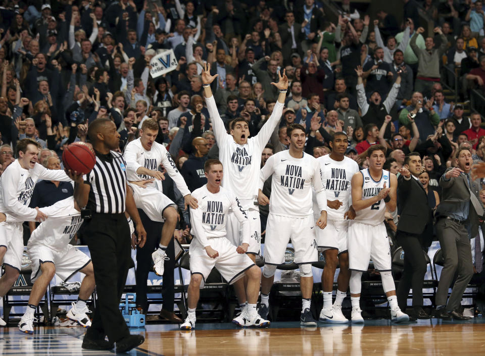 Players on the Villanova bench celebrate a Villanova basket against West Virginia during the second half of an NCAA men's college basketball tournament regional semifinal Friday, March 23, 2018, in Boston. (AP Photo/Mary Schwalm)