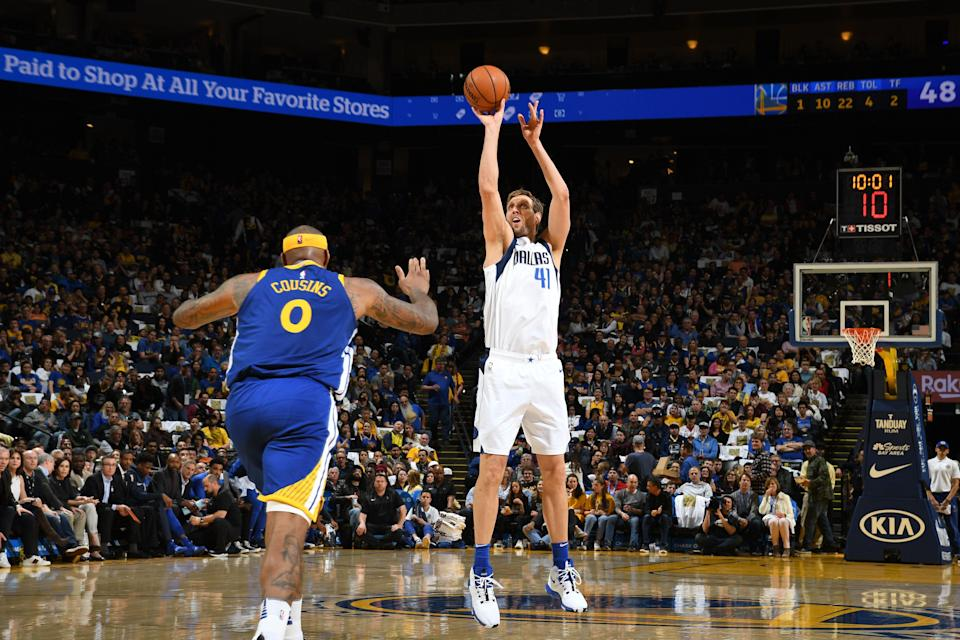 OAKLAND, CA - MARCH 23: Dirk Nowitzki #41 of the Dallas Mavericks shoots three point basket against the Golden State Warriors on March 23, 2019 at ORACLE Arena in Oakland, California. NOTE TO USER: User expressly acknowledges and agrees that, by downloading and or using this photograph, user is consenting to the terms and conditions of Getty Images License Agreement. Mandatory Copyright Notice: Copyright 2019 NBAE (Photo by Noah Graham/NBAE via Getty Images)
