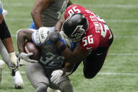 Atlanta Falcons defensive end Dante Fowler Jr. (56) stops Detroit Lions running back D'Andre Swift (32) during the second half of an NFL football game, Sunday, Oct. 25, 2020, in Atlanta. (AP Photo/John Bazemore)