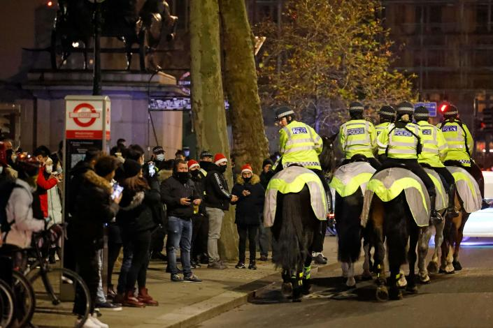 Mounted police officers patrol The Victoria Embankment as groups of revellers gather in a near-deserted London late on New Year's Eve, December 31, 2020, as authorities in the Tier 4 city hope the message to stay at home is obeyed. (Photo by Tolga Akmen / AFP) (Photo by TOLGA AKMEN/AFP via Getty Images)
