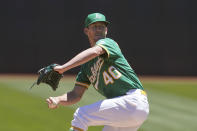 Oakland Athletics' Chris Bassitt pitches against the Kansas City Royals during the first inning of a baseball game in Oakland, Calif., Sunday, June 13, 2021. (AP Photo/Jeff Chiu)