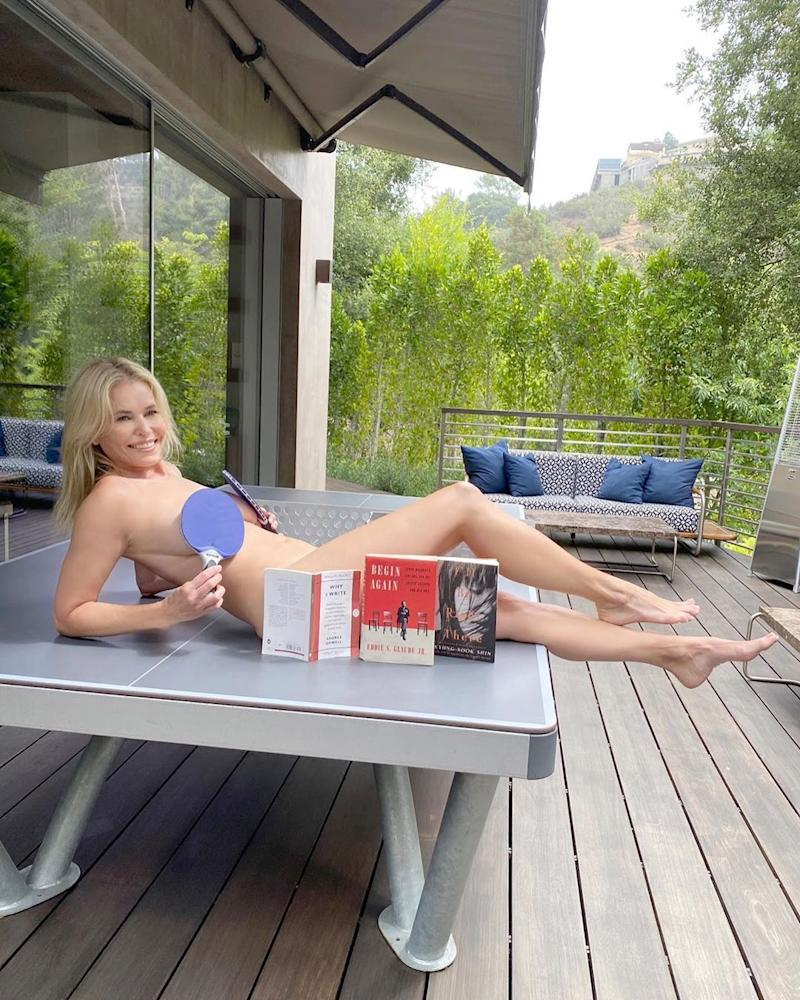 Chelsea Handler naked on a table of books