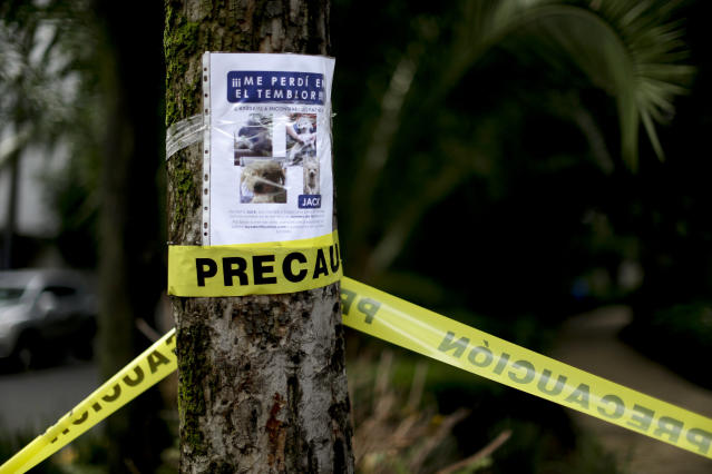 <p>A flyer seeking a missing pet named Jack is posted on a tree, in Mexico City, Friday, Sept. 22, 2017. Jack is a small white dog who lives in Mexico City and has been missing since a magnitude 7.1 earthquake startled both humans and their pets when it struck early Tuesday afternoon. (Photo: Natacha Pisarenko/AP) </p>
