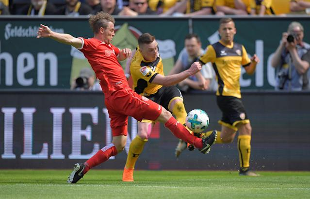 Soccer Football - 2. Bundesliga - Dynamo Dresden v Fortuna Dusseldorf - DDV-Stadion, Dresden, Germany - April 28, 2018 Dynamo Dresden's Haris Duljevic in action with Fortuna Dusseldorf's Julian Schauerte REUTERS/Matthias Rietschel DFL RULES TO LIMIT THE ONLINE USAGE DURING MATCH TIME TO 15 PICTURES PER GAME. IMAGE SEQUENCES TO SIMULATE VIDEO IS NOT ALLOWED AT ANY TIME. FOR FURTHER QUERIES PLEASE CONTACT DFL DIRECTLY AT + 49 69 650050