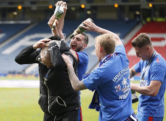 "Football - Falkirk v Inverness Caledonian Thistle - William Hill Scottish FA Cup Final - Hampden Park, Glasgow, Scotland - 30/5/15 Inverness Caledonian Thistle's manager John Hughes celebrates with Graeme Shinnie after the match Reuters / Russell Cheyne Livepic EDITORIAL USE ONLY. No use with unauthorized audio, video, data, fixture lists, club/league logos or ""live"" services. Online in-match use limited to 45 images, no video emulation. No use in betting, games or single club/league/player publications. Please contact your account representative for further details."
