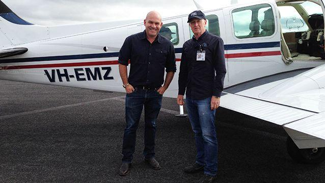 RBA Governor Glenn Stevens (right) flies his twin-engine Beechcraft Baron for Angel Flight. Pictured here with 7News reporter Mike Duffy.